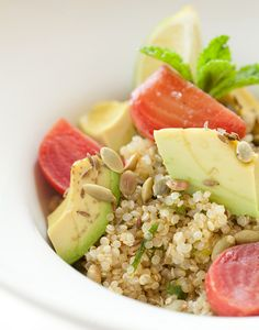 Quinoa Salad dressed in lime, scallion and mint, candy beets, avocado, pumpkin seeds, toasted cumin