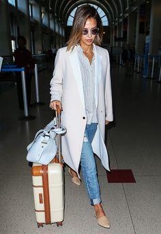 White jacket, light washed jeans, collared shirt