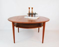 Danish Modern Teak Round Coffee Table with magazine shelf by Peter Hvdit / France and Son