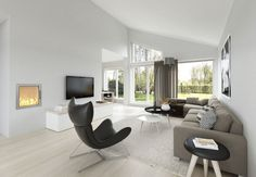 sparse decorating | Living Room, Modern White Interior Decorating With Comfort Grey Sofa ...