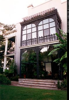 Anne Rice, american gothic fiction auther, former home in New Orleans Garden District, LOVEEEE all the glass and metal work. Side view of a Double-gallery home with a custom black iron and glass greenhouse side attachment. too perfect New Orleans Mansion, New Orleans Homes, New Orleans Louisiana, Louisiana Homes, New Orleans Garden District, Haunted Tours, Side Porch, Anne Rice, Street House