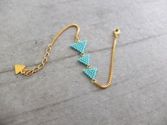 gold-plated pennants: Bracelet by my-fr .doré à l'or fin : Bracelet par my-french-touch Bracelet? gold-plated pennants: Bracelet by my-french-touch - Beaded Earrings, Beaded Jewelry, Handmade Jewelry, Bridal Jewelry, Handmade Bags, Jewelry Necklaces, Bead Loom Bracelets, Embroidery Bracelets, Bijoux Diy
