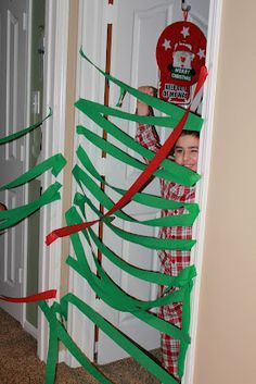 Christmas morning run through streamers! There needs to be an elf on the shelf swinging from a streamer!