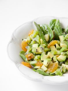 10. Spinach, Avocado, and Kiwi Salad This salad is primarily made of fruit, with spinach playing second fiddle. Featuring kiwis (containing 117 percent of the daily recommended value of vitamin C) and avocados (which are loaded with healthy fats and vitamins like B6, which promote healthy skin), these superfruits make this salad super-delicious.