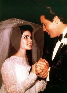 Elvis Presley & Priscilla Beaulieu May 1, 1967.  Priscilla wore a white chiffon gown, with beaded yoke (illusion neckline), trimmed with pearls.