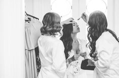 Bride getting ready on her wedding day in Homebodii's White Helena Long Lace Bridal Robe. Perfect for wearing when getting your hair and make-up done before the ceremony.