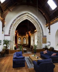 The home also boasts a spectacular open living space with high ceilings, stained glass windows, and double staircase and balcony. And when the winter cold strikes, heating is courtesy of six Victorian cast iron radiators.