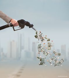 The high cost of gasoline! New stock image of a gas nozzle spewing out money for Blend Images. www.johnlund.com