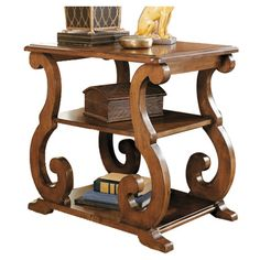 End table with 2 lower display shelves and scrolling legs.  Product: Side tableConstruction Material: Birch soli...