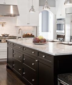 Love this combination of dark cabinets with white