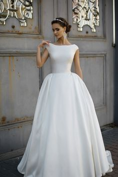 Kolett - Delicate Pearl - MillaNova Amazing wedding dress for those who appreciate simplicity and elegance. Made of classy Mikado tissue tie bodice with bateau neckline and lush skirt with puffs sewn on the sides for additional volume. Classic gown with buttoned up bare back and mid-long train to accentuate bridal tenderness and style.