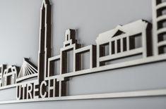 De skyline van Utrecht bestaat onder andere uit de iconen: de Dom, de Inktpot, de Rabotoren en de Prins Clausbrug.