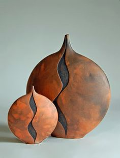 Ann-Wilson-Ceramics - pair of ceramic vessels with abstract motif in black on a rusty orange