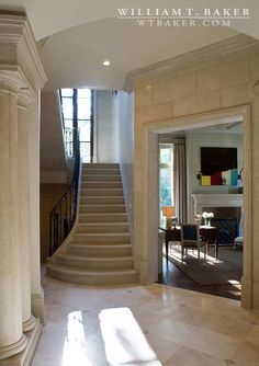 William T. Baker | columns, French, French provincial, iron railing, landing, living room, stone risers, stone treads, window