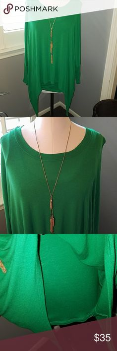Neiman Marcus Sharkbite hem, green bat sleeves M Built in tank under webbed arms and shark bite hemline. Kelly green Rayon/spandex blend. Runs large. (necklace not for sale) Neiman Marcus Tops Blouses
