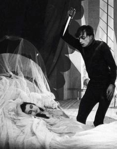 The Cabinet of Dr. Caligari Cesare the Sonambulist (Conrad Veidt) gets ready to stab a sleeping Jane (Lil Dagover). Silent Horror, Silent Film, Dr Caligari, Tv Movie, Berlin, Bagdad, Classic Horror Movies, Film Inspiration, Classic Monsters