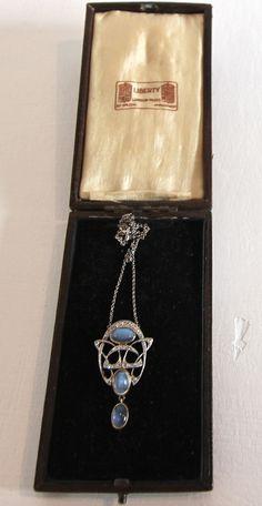 Art Nouveau platinum and diamond pendant by Archibald Knox