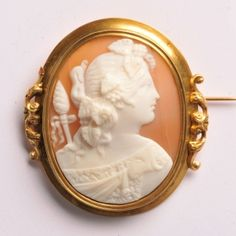 Shell cameo brooch of a woman in profile to the right, white on orange/grey background.  Set in an 18 carat gold frame.  42 x 48mm  www.osprey.fr  €900 Orange Grey, Gray Background, Carat Gold, Vintage Jewelry, Shell, Profile, Paris, Jewels, Woman