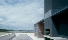 Outdoor terrace and built in fireplace with a view of Padstow, Camel Quarry by McLean Quinlan, Remodelista