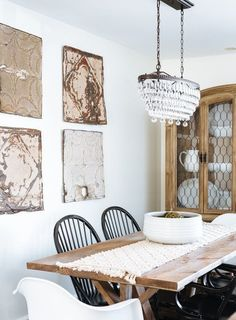 A crystal tiered chandelier balances a rustic style dining room for a modern look.