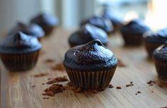 Chocolate cupcakes with dark chocolate yogurt glaze.