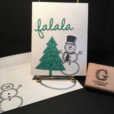 Christmas Stamp-a-Stack on 29October2016: Stamp sets SNOW PLACE and PEACEFUL PINES from the 2016-2017 Inspiration catalog. Card stock is Whisper White and Emerald Envy. Ink colors Basic Black, Emerald Envy, Tip Top Taupe and Whisper White; marker in Tangerine Tango for carrot/nose. Framelits Snow Friends, Perfect Pines and Seasonal Frames. TIEF Softly Falling. All supplies & images by Stampin'Up!