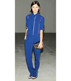 Emily Weiss at the Calvin Klein Collection S/S 14 after-party in New York.   On Emily: Reed Krakoff blouse, pants, and clutch, YSL Classic Jane Ankle Strap Sandals