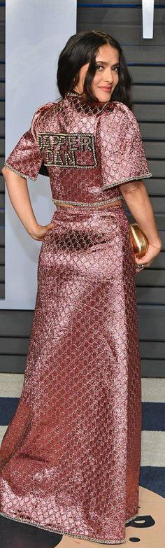 Who made  Salma Hayek's pink gown and handbag?