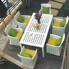 Suitable for the patio, garden or balcony, this table with six seats is perfect for relaxing outside. www.everything.house