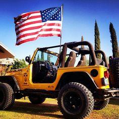 Patriotic yellow jeep