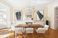 Elegant dining space with herringbone floors, classic architecture and a gold chandelier #classicalarchitecture