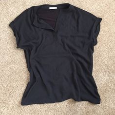 Black Drape Top Super cute draping top goes great with jeans and heels or a skirt (as in photo). Polyester front and modal back so it hugs in the right places. Purchased at Nordstrom, brand is Pleione. Tops Blouses