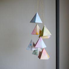 DIY—hanging geometric papershapes.