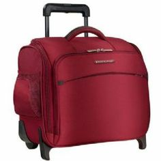 Travel in luxury with this bright Red sleek, stylish carry-on case from Briggs & Riley. The Briggs & Riley Transcend Rolling Cabin Bag is crafted from Tuff-Lite™ fabric with a soft and durable design and multiple pockets for all of your essential items. From luggagedesigners.com