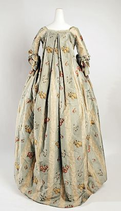 Back view, robe à la francaise, North America, 1765-1780. Cream and pale blue striped silk brocaded with floral sprays in multicoloured silk threads.