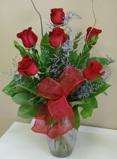 An arrangement of 6 red roes by your local Riverside florist - Willow Branch Florist of Riverside http://www.floristofriverside.com/