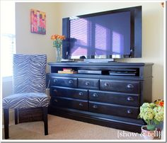 Great idea for turning a dresser into a tv stand.  (I'm thinking Sara's old wood dresser, repainted, remove the drawers for storage space).