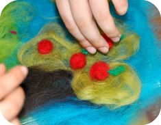 painting with wool - wet felting with kids