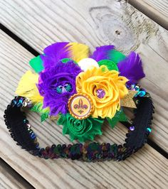 A personal favorite from my Etsy shop https://www.etsy.com/listing/263229837/mardi-gras-feather-headband-fleur-de-lis