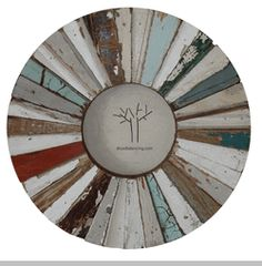 insert your favorite photographic memory in this reclaimed wood round frame mixed and matched strips of old floor and ceiling wood in varying colors and