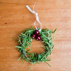 DIY Fun: Adorable Mini Holiday Herb Wreaths. Would love to hang these on some knobs in the kitchen. #SeasonsEatings and #HarrisTeeter