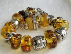 Carved Ambers from a collector on Trollbeads Gallery Forum