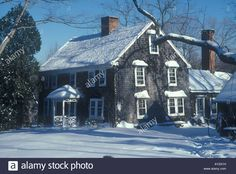 New England colonial period  farmhouse under January snow, dated circa 1740 in Lyme Connecticut Stock Photo