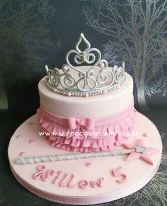 Sugar princess tiara on pink ruffles birthday cake for girls.