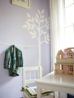 15 Fun Ways to Organize Kids' Rooms and Nurseries --- hang items at kids height