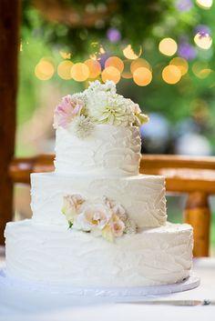 Three-Tier Wedding Cake with Florals   Brides.com