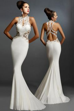Shimmering floral appliques on mesh accent the sheath silhouette of this Open Back Fine Flowers #Wedding Evening #Gown, defining the sweetheart bodice with illusion side cutouts which meet beneath the cutout back. #LongDress #Fashion