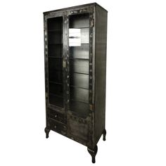 Vintage Industrial Display/Storage Cabinet | From a unique collection of antique and modern bookcases at https://www.1stdibs.com/furniture/storage-case-pieces/bookcases/