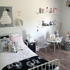 nice use of Ikea ribba shelves and cool use of play kitchen as night table :-)
