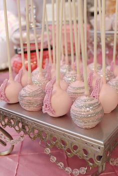 Glittery cake pops at a  Parisian birthday party! See more party ideas at CatchMyParty.com!